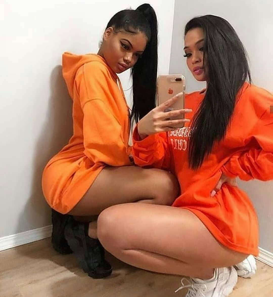 two hot, and cute ladies slays in orange (photo) - 9jaflaver