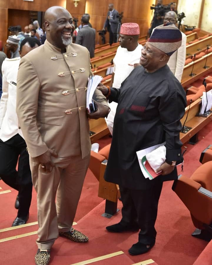 Senators Dino Malaye And Adeleke Laugh Together At The Senate House