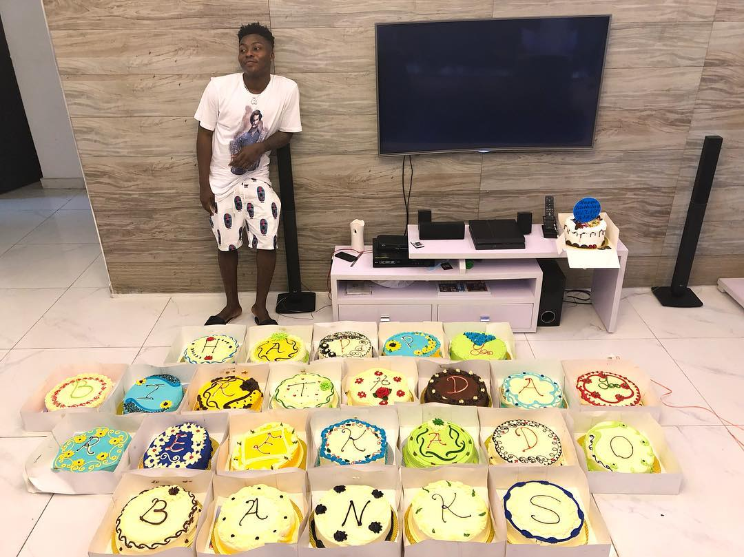 Popular Mavin Act Reekado Banks Who Is Celebrating His 25th Birthday Todays 25 Cakes Was Presented To Him By Lookalike Brother Celebrates
