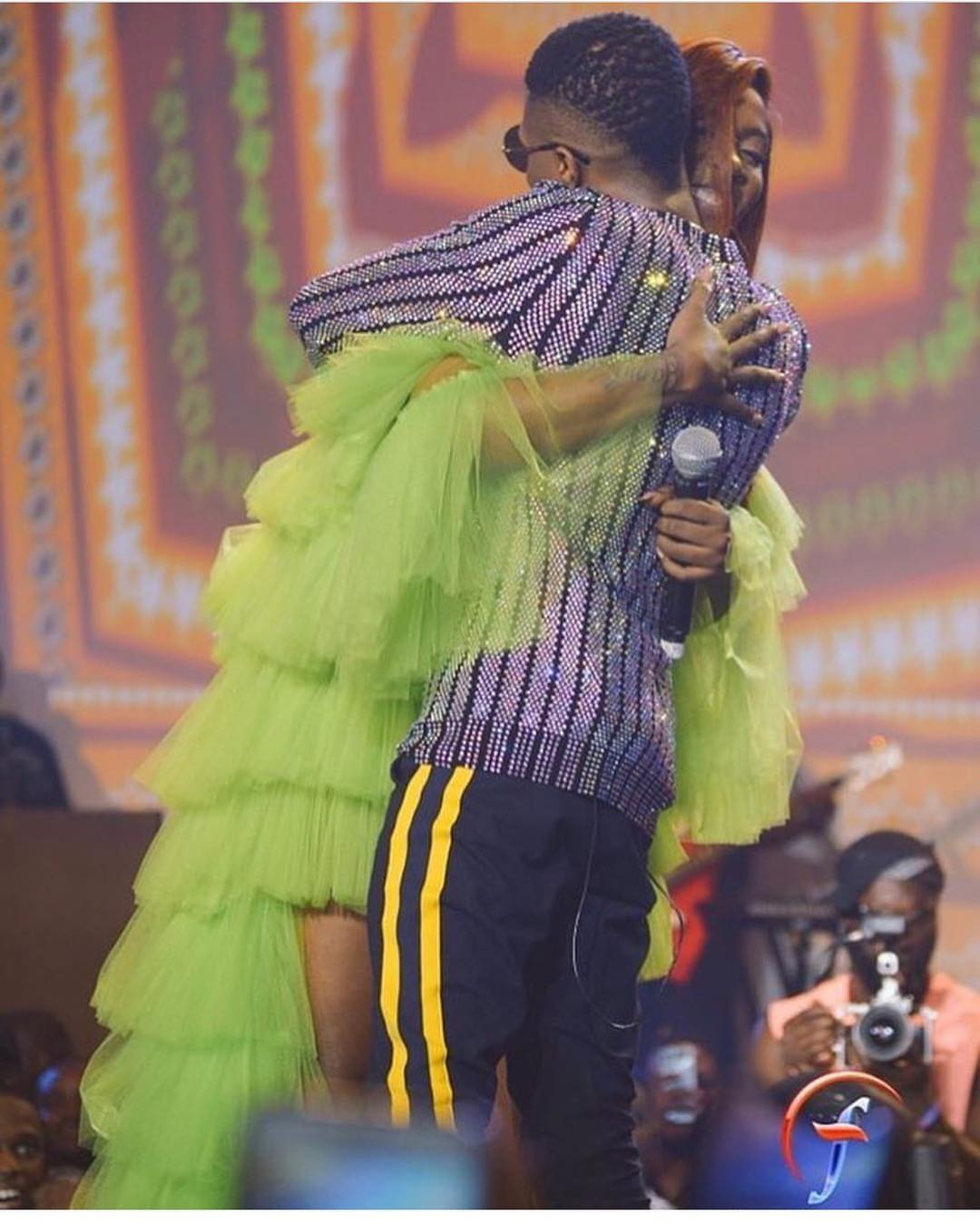 Adorable Moment At Wizkid Concert As Tiwa Savage Hugs Wizkid