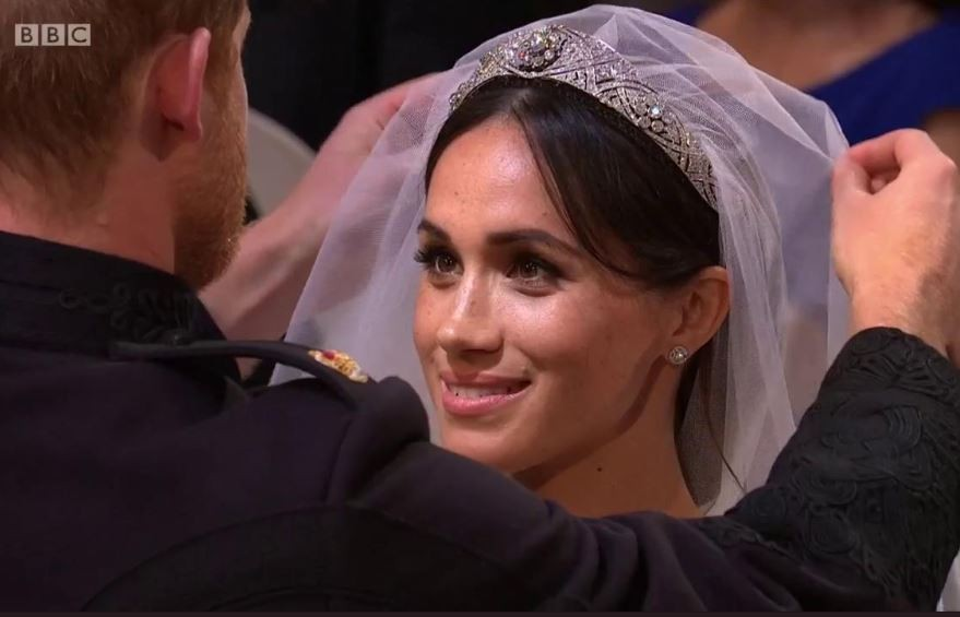 RoyalWedding: Prince Harry And Meghan Markle All Smiles As He Removes Her Veil (Photos)