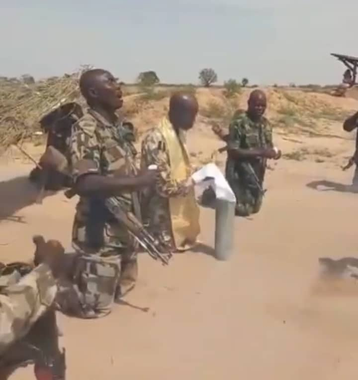 Soldiers Fighting Boko Haram Kneel Down, Sing And Pray With Riffles