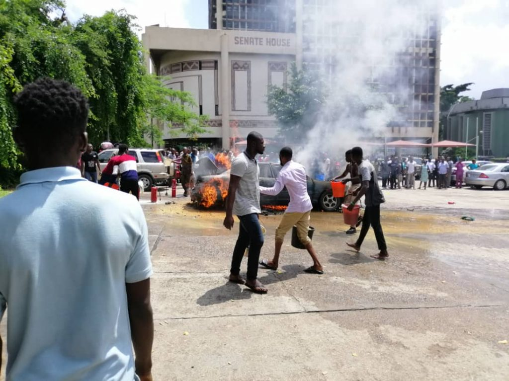 Fire Outbreak In UNILAG, Car Explodes, Fire Figthers Use Buckets To Quench Fire