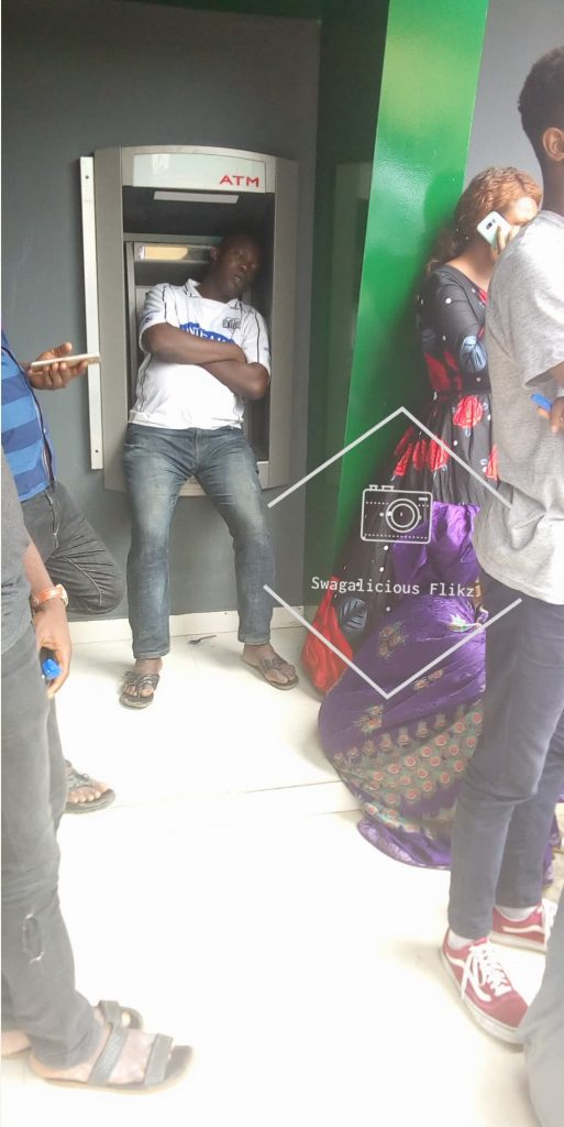 Man Pictured Taking A Nap On ATM At Immigration Office Ikoyi