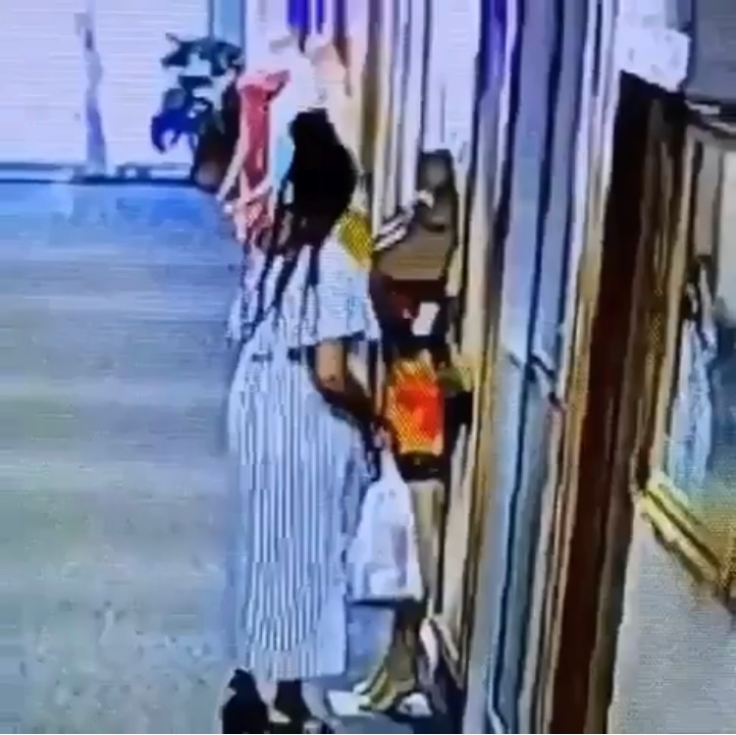 Slay Queen Caught On CCTV Stealing Dress Outside A Boutique
