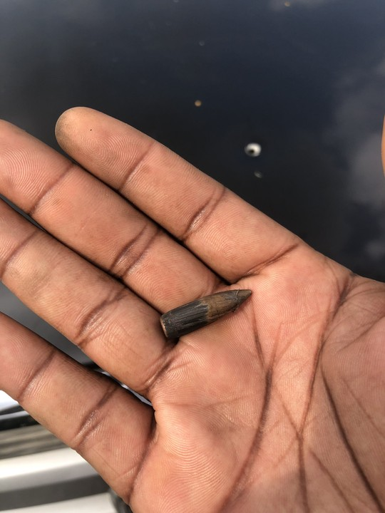 FLY Bullet Pierces Through Man's Car While Driving Along Ikorodu, Lagos