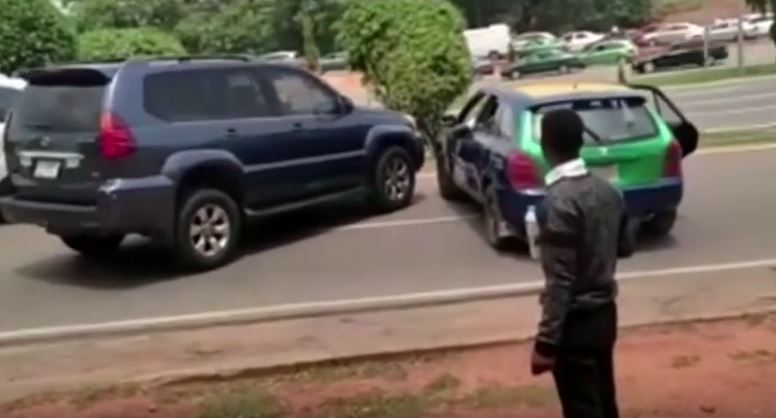 Drama As Cab Driver And SUV Driver Clash In The Middle Of A Busy Road In Abuja